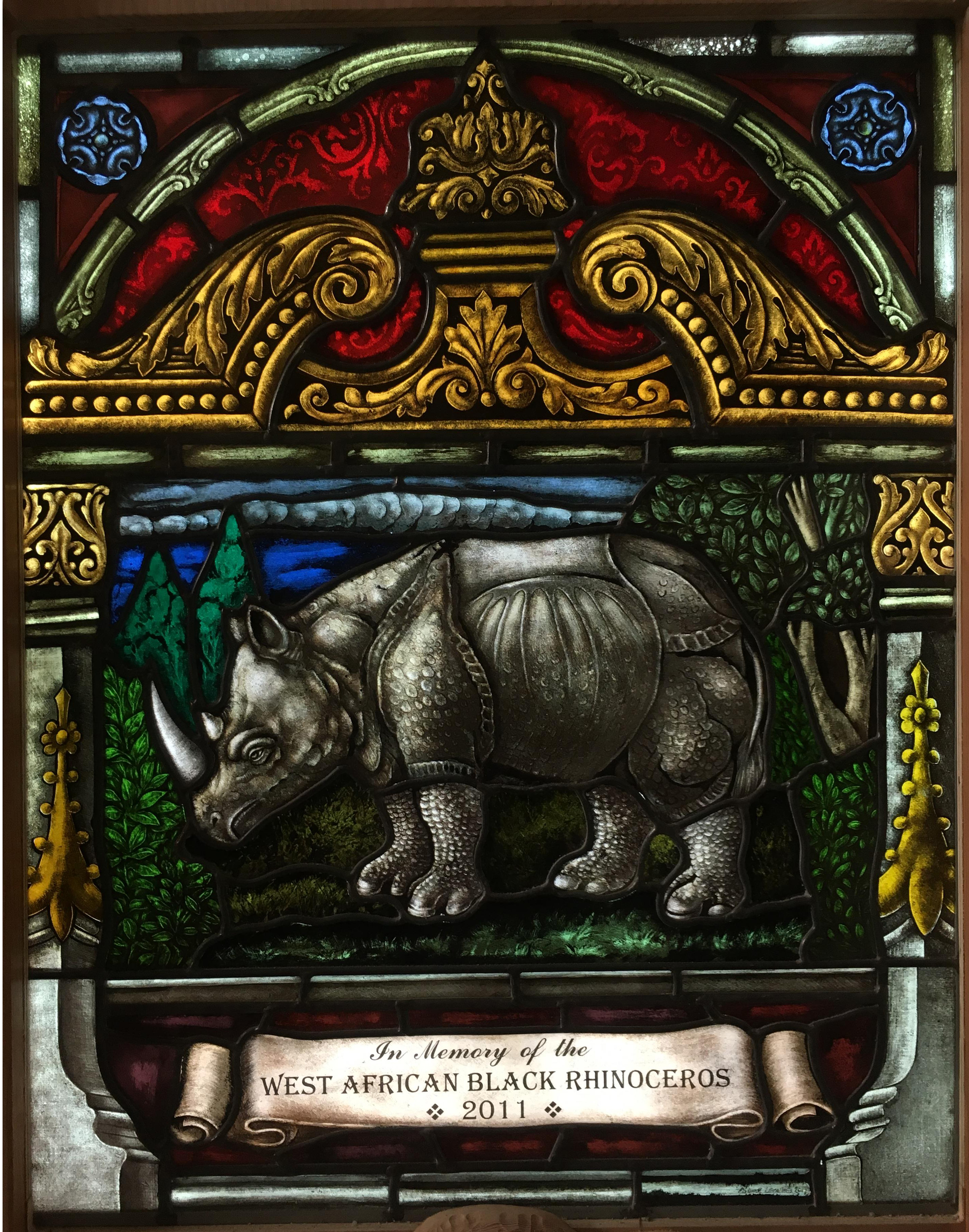 A stained glass memorial window for the extinct West African Black Rhino, inspired by Albrect Durer's woodcut of a Rhinoceros from 1515.